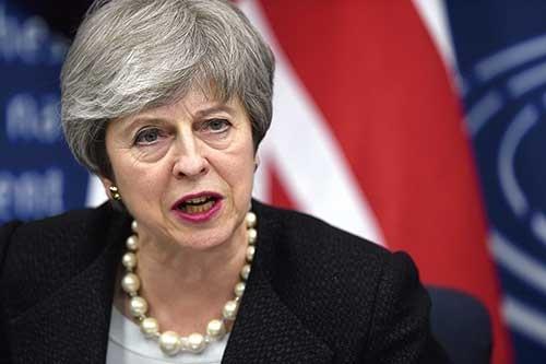 """<span class=""""fontBold"""">「私の案か、合意なき離脱か」とメイ首相は議会に迫ったが……</span>(写真=AFP/アフロ)"""