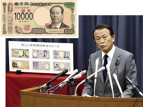"""<span class=""""fontBold"""">新紙幣のデザインを発表する麻生太郎財務相。新1万円札の図柄は渋沢栄一</span>(写真=下:共同通信)"""