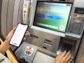 セブン銀、ATMの新たな使い道に透ける危機感
