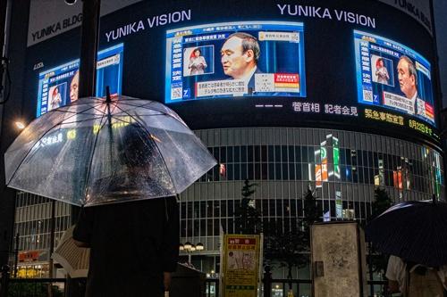 菅義偉首相は「病床の状況などに改善が見られる場合は前倒しで解除することも判断する」と述べた(写真=アフロ)