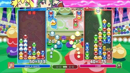 「ぷよぷよeスポーツ」。左右で対戦し、上から落ちてくる「ぷよ」を、同じ色をつなげて消していく。一度に、あるいは連続技で大量に消すと、相手に「おじゃまぷよ」を降らせることができる(画像:セガゲームス、以下同)