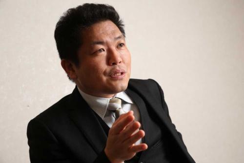 中澤准教授は、低い最低賃金が人手不足の原因になっていると指摘する(写真=陶山 勉)