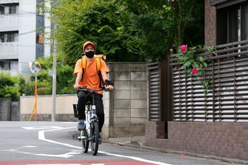 7分以内のエリアに電動自転車で配送。ライダーは時給1500円の固定給であるのもOniGOの特徴だ