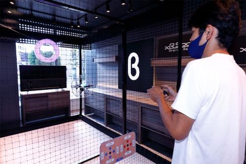 有楽町店にはイベントスペースも用意。9月中旬時点では、ドローンを実際に飛ばせる体験ゾーンを展開していた