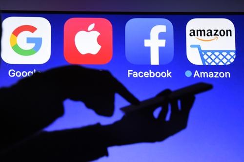 米国の大手テック企業は、税制の混乱を回避できるか(写真:AFP/アフロ)