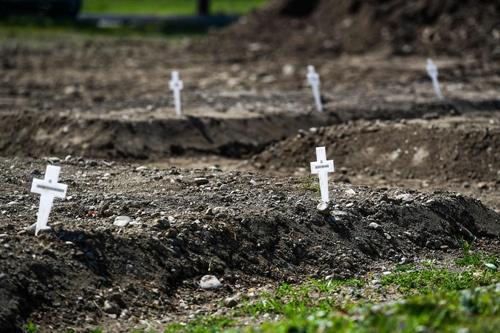 コロナ禍で世界では160万人以上の命が失われている(写真:AFP/アフロ)