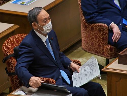 菅首相は東京オリンピック・パラリンピックにどう臨むのか(写真:アフロ)