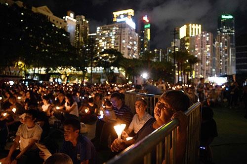 天安門事件から29年目の今年、香港で開かれた追悼集会(写真:AFP/アフロ)