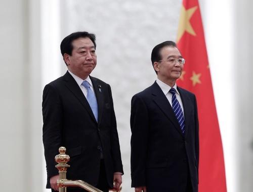 前回の首相訪中は2011年12月、日中関係が悪化するなか、当時の野田首相が温家宝首相と会談した(写真:AP/アフロ)