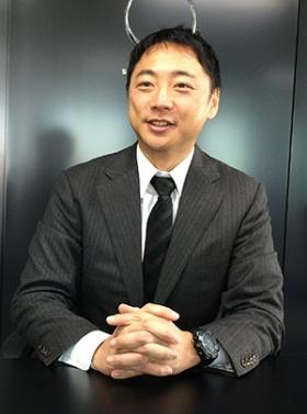 「主婦らの負担を何とか軽減したい」と語る阪根社長