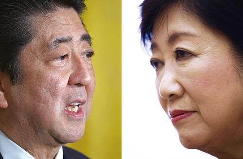 <b>東京五輪を控え、表向き協調姿勢の安倍首相と小池都知事。自民内では支持層を奪われることへの警戒感が強まっている</b>(写真=2点:AFP=時事)