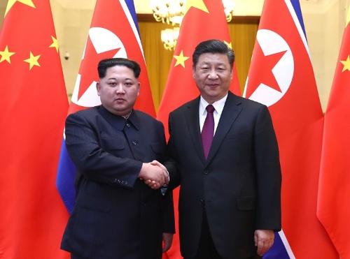 金正恩委員長は3月25―28日、中国を訪問し、習近平国家主席と会談した(写真:新華社/アフロ)