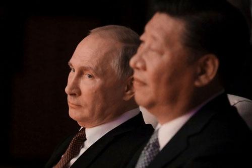 プーチン大統領と習近平主席、それぞれの思惑は…(写真:ロイター/アフロ)