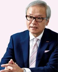 「低価格を続けたことで現場にしわ寄せもあった」と話す大倉忠司社長(写真=大槻 純一)