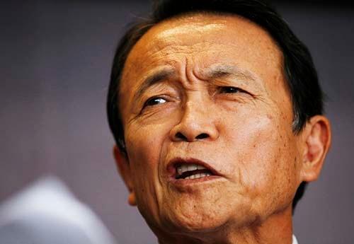 麻生太郎・副総理兼財務相は、「労働分配率」の低下に苦言を呈する。(写真:ロイター/アフロ)