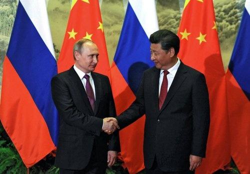 6月末のプーチン大統領訪中の際には、共同声明から個々の経済協力の覚書まで含めて、両国が調印した合意文書は合計で37に上ったが…(写真:Kremlin/Sputnik/ロイター/アフロ)
