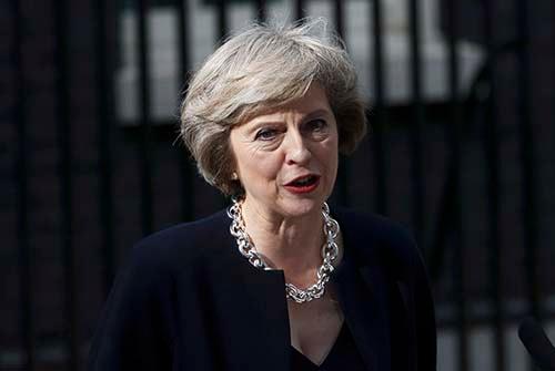 髪形、クイーンズ・イングリッシュ…「鉄の女」サッチャー元首相をほうふつさせる、テリーザ・メイ英首相 (写真:ロイター/アフロ)