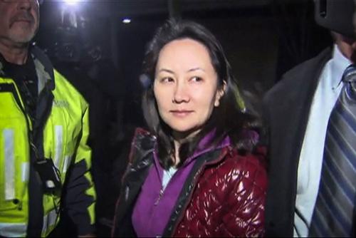 米国は、カナダに要請して華為技術の孟晩舟・副会長を逮捕するなど、同社への締め付けを強めている(写真:CTV/AFP/アフロ)