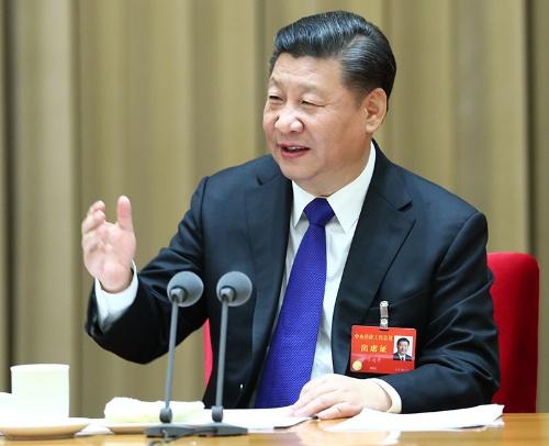 19年12月に開かれた中央経済工作会議で発言する習近平国家主席(写真:新華社/アフロ)
