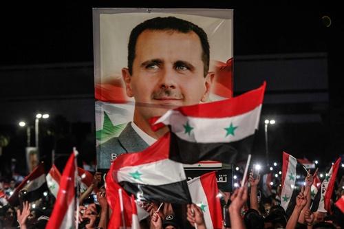シリアのアサド大統領は得票率は95.1%で4戦を果たした(写真:AFP/アフロ)