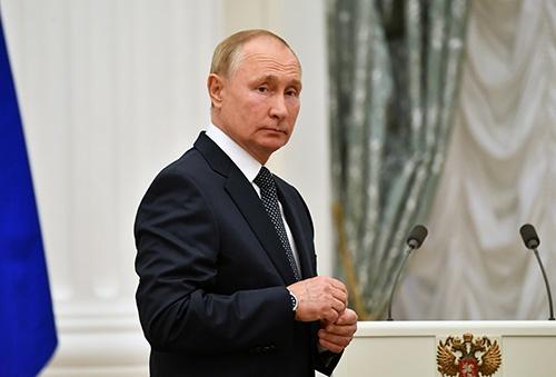 ロシア下院選挙を目前に控えるプーチン大統領(写真:ロイター/アフロ)