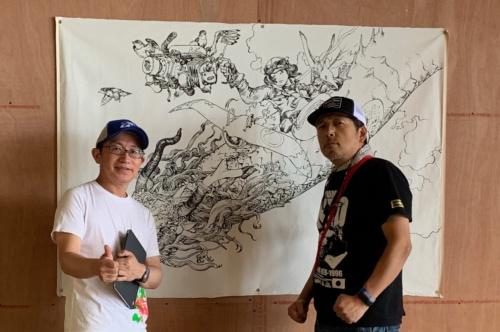 ライブドローイングを描いてくれた寺田克也さん(写真右)と。