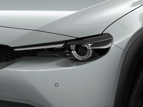 シグネチャーウイングはないが、彫りの深さや動物の目のようなヘッドランプは他のマツダ車と共通(写真:マツダ)