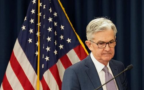 米連邦準備理事会(FRB)が緊急利下げ。事実上のゼロ金利導入を発表したジェローム・パウエル議長(写真:ロイター/アフロ)