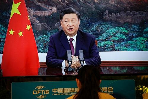 習近平・国家主席はTPP加盟を積極的に検討すると明言していた(写真:ロイター/アフロ)